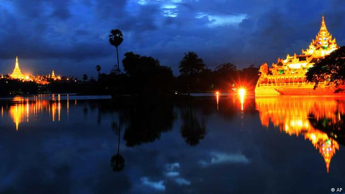 In this photo taken Tuesday, Sept. 20, 2011, Myanmar's landmark Shwedagon pagoda, left, and Karaweik Palace, right, are seen from National Kandawkyi park when it is illuminated in Yangon, Myanmar. (ddp images/AP Photo/Khin Maung Win)
