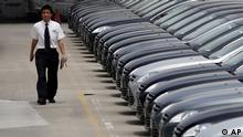 A man walks past brand new cars at a car dealer in Shanghai, China, Wednesday June 8, 2011. Foreign automakers are seeing mixed sales trends in China as the world's biggest market for new vehicles cools after years of torrid growth. (ddp images/AP Photo/Eugene Hoshiko)