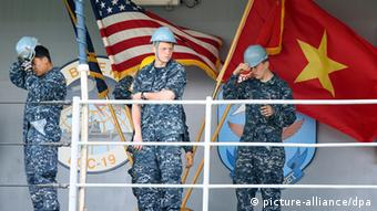 US Navy sailors stand on the Seventh Fleet flagship USS Blue Ridge upon its arrival in Danang, Vietnam, 23 April 2012. Vietnam and the US will participate in a five day naval exchange in Danang from 23 to 27 April 2012. The goodwill exchange activities which focus on non-combatant events and skills exchanges, as tensions between Vietnam and China continue to rise over the much disputed Spratly Islands in the South China Sea. EPA/LUONG THAI LINH pixel