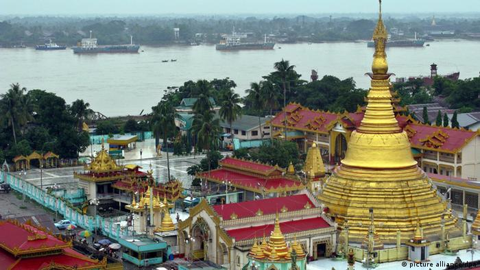 cargo freighters on the Yangon River and the BoTaTaung Pagoda in BoTaTaung Township
