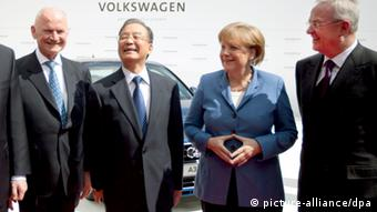 Angela Merkel (middle right) and Wen Jiabao (middle left) visit VW factory in Wolfsburg in April, 2012