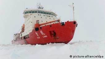 China's ice breaker Xuelong or Snow Dragon is blocked by thick ice around the Antarctica