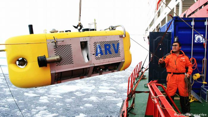 A member of China's third Arctic expedition helping drag the underwater robot Arctic ARV out of the Arctic Ocean.