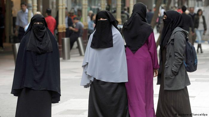 Women wearing the burqa or a face covering participate in a flash mob protest in the central business district, Sydney, Australia, on 17 May 2010. The protest called on participants to don an outfit to conceal their faces to highlight burqa bans in Europe. (Copyright: EPA/Dean Lewins)