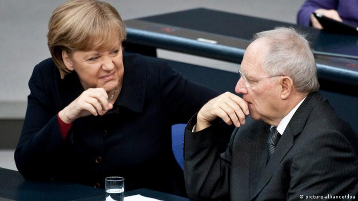 Chancellor Angela Merkel talking to Finance Minister Wolfgang Schäuble