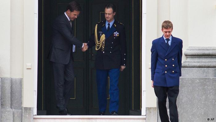 Dutch prime minister Mark Rutte, left, leaves royal palace