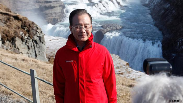 Chinese Premier Wen Jiabao poses before Gullfoss waterfall April 21, 2012. Wen landed in Iceland on Friday to begin a tour of northern Europe that will focus on Chinese investment in a continent eager for funds from the fast-growing Asian power. REUTERS/Ingolfur Juliusson (ICELAND - Tags: POLITICS)