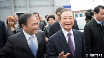Chinese Prime Minister Wen Jiabao (C) and Li Shufu (L), Chairman of Volvo owner Geely, smile upon arrival at the Volvo car factory in Gothenburg April 24, 2012 . Wen is in Sweden for a three-day official visit in Sweden. REUTERS/Bjorn Larsson Rosvall/Scanpix Sweden (SWEDEN - Tags: TRANSPORT POLITICS BUSINESS) FOR EDITORIAL USE ONLY. NOT FOR SALE FOR MARKETING OR ADVERTISING CAMPAIGNS. THIS IMAGE HAS BEEN SUPPLIED BY A THIRD PARTY. IT IS DISTRIBUTED, EXACTLY AS RECEIVED BY REUTERS, AS A SERVICE TO CLIENTS. SWEDEN OUT. NO COMMERCIAL OR EDITORIAL SALES IN SWEDEN