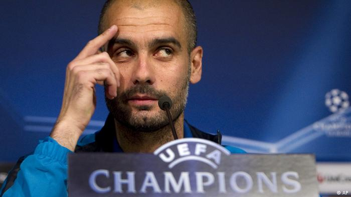 FC Barcelona's coach Josep Guardiola gestures during a news conference at the Santiago Bernabeu stadium, Madrid, Tuesday, April 26, 2011. FC Barcelona will play against Real Madrid Wednesday in Madrid. (AP Photo/Arturo Rodriguez)