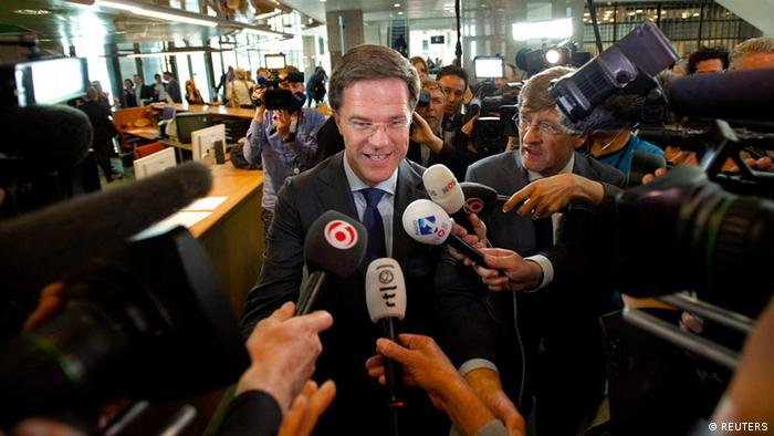 Prime Minister Mark Rutte arrives for a debate in the Dutch parliament about the government's resignation caused by a crisis over budget cuts in The Hague April 24, 2012. Rutte offered his minority Liberal-Christian Democrat coalition's resignation to Queen Beatrix of the Netherlands after a split with the populist Freedom Party of Geert Wilders, opening the way for early elections. REUTERS/Robin van Lonkhuijsen/United Photos (NETHERLANDS - Tags: POLITICS)