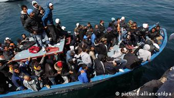 A boat full of illegal immigrants at Lampedusa, Italy