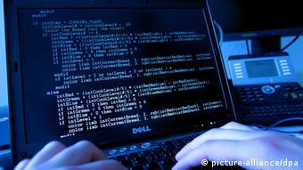 A stock picutre simulating a hacker writing code.