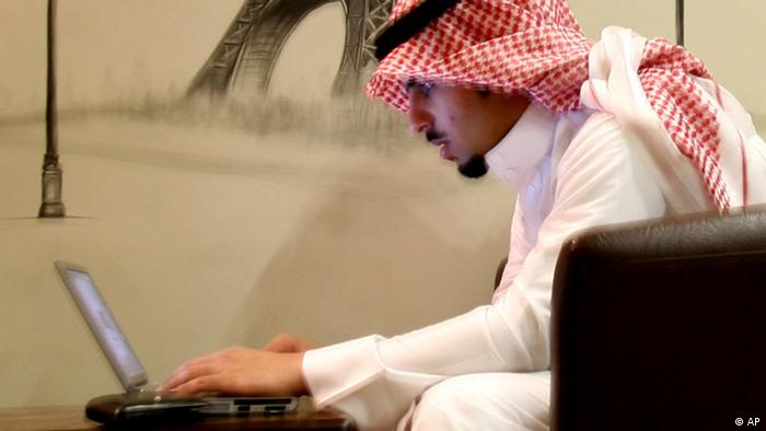 A man uses a laptop in Riyadh, Saudi Arabia
