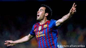 Sergio Busquets celebrates his goal, arms outstretched