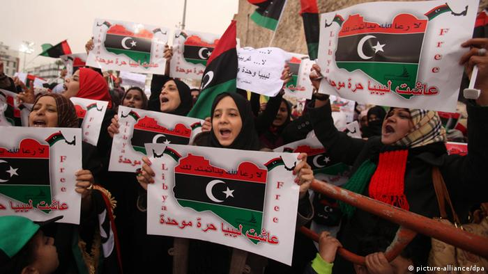 Thousands of Libyans with Libya flags and anti-federalization signs and banners gather during a protest against transforming Libya into a federal state, in Tripoli, Libya, 09 March 2012. Tribal leaders in eastern Libya on 06 March declared the Cyrenaica region to be semi-autonomous, in a move that could revive old tensions in Libya. Thousands of major tribal leaders and militiamen attended the ceremony in the city of Benghazi, the birthplace of last year's uprising against former leader Muammar Gaddafi. EPA/SABRI ELMHEDWI