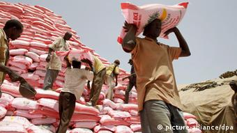 Men loading a truck with bags of rice from Thailand, Dakar, Senegal, 2008. (Photo: Maxppp De Poulpiquet (c) dpa)