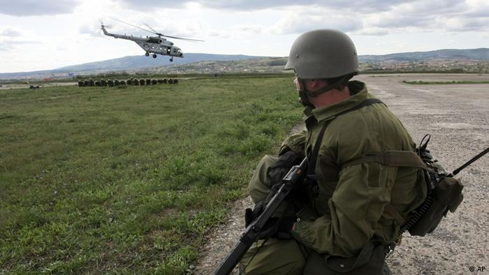 German peacekeepers are deployed from a helicopter in Kosovo during a military exercise