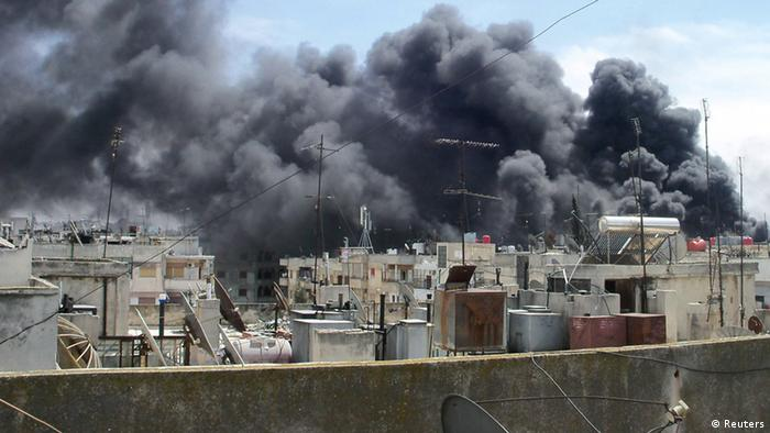 Smoke rises from the Al Qusoor district of Homs in this handout picture dated April 14, 2012.