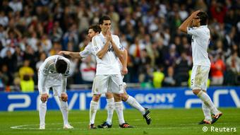 Real Madrid's players react after the penalty shootout