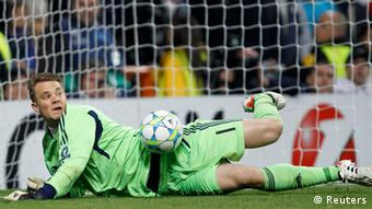 Bayern Munich's goalkeeper Manuel Neuer saves a penalty shot from Real Madrid's Cristiano Ronaldo