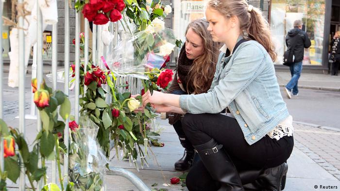 Marie Naess and Aashild Nestdgaard Roe (R), both 16, tie roses onto railings outside a courthouse where Norwegian anti-Muslim fanatic Anders Behring Breivik is standing trial, in Oslo April 24, 2012. Breivik, 33, is on trial for killing 77 people in a shooting and bombing rampage last July. REUTERS/Haakon Mosvold Larsen/NTB Scanpix (NORWAY - Tags: CRIME LAW CIVIL UNREST) THIS IMAGE HAS BEEN SUPPLIED BY A THIRD PARTY. IT IS DISTRIBUTED, EXACTLY AS RECEIVED BY REUTERS, AS A SERVICE TO CLIENTS. NORWAY OUT. NO COMMERCIAL OR EDITORIAL SALES INNORWAY