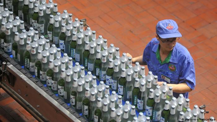 A worker works at a production line belonging to Tsingtao Brewery in China