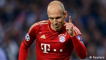 Bayern Munich's Arjen Robben celebrates a goal against Real Madrid during their Champions League semi-final second leg soccer match at Santiago Bernabeu stadium in Madrid, April 25, 2012. REUTERS/Felix Ordonez (SPAIN - Tags: SPORT SOCCER)