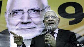In this Friday, March 9, 2012 file photo, Egyptian Presidential hopeful Abdel-Moneim Abolfotoh talks under a giant billboard showing his picture during a conference in Cairo, Egypt.