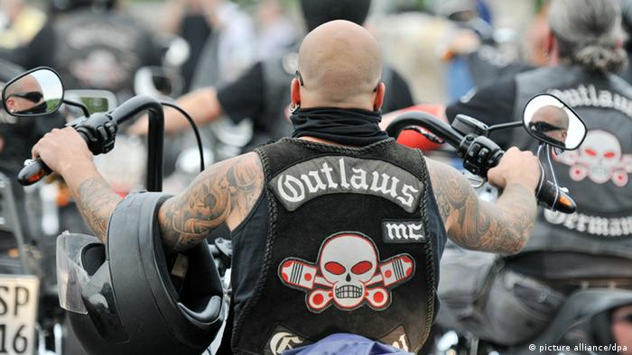 A member of the Outlaw biker gang on his motorcycle