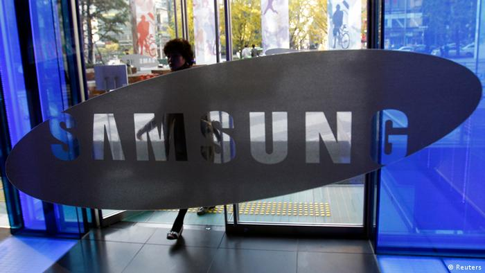 A visitor passes by the logo of Samsung Electronics Co. at a showroom of its headquarters in Seoul, South Korea, Friday, Oct. 28, 2011. Samsung's net profit has slid 23 percent in the third quarter despite strong smartphone sales. (ddp images/AP Photo/Lee Jin-man)