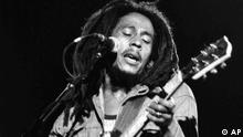 FILE - In this July 4, 1980 file photo, Jamaican Reggae singer Bob Marley performs at a reggae festival concert in Paris. The widow and nine children of Bob Marley are suing his half-brother in Florida to stop use of the Marley name to promote an annual Miami music festival and other businesses. (AP Photo/file)