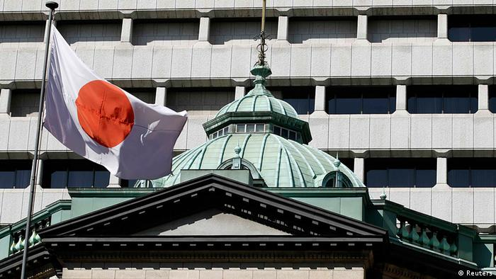 A Japanese flag flutters atop the Bank of Japan headquarters