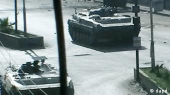Tanks seen in Douma City (Photo:Shaam News Network via AP video/AP/dapd)