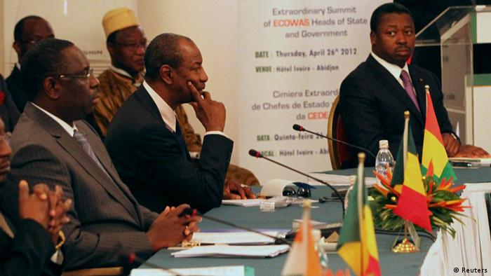 From (L to R) Senegal's President Macky Sall, Guinea's President Alpha Conde and Togo's President Faure Gnassingbe attend an Economic Community of West African States (ECOWAS) meeting to discuss the Mali crisis and Guinea-Bissau's coup in Abidjan April 26, 2012. REUTERS/Luc Gnago (IVORY COAST - Tags: POLITICS)
