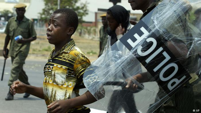 Zambian police arrest a political supporter. (AP)