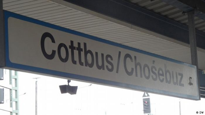 A sign for Cottbus at a train station