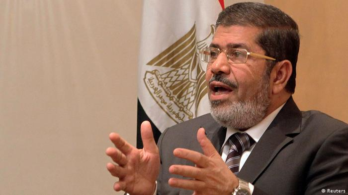 Mohamed Mursi, head of Muslim Brotherhood's political party, and Brotherhood's new presidential candidate, talks during interview with Reuters in Cairo.
