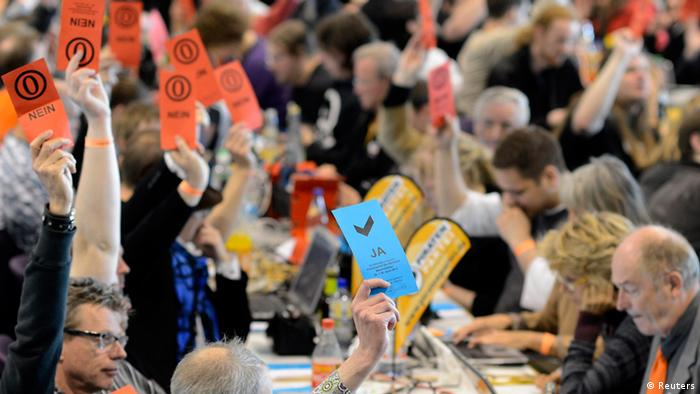Delegates of Germany's Pirate Party (Piraten Partei) vote at their party convention in Neumuenster April 29, 2012. REUTERS/Fabian Bimmer (GERMANY - Tags: POLITICS)