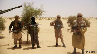 Fighters from Islamist group Ansar Dine outside Timbuktu