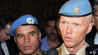 Norwegian Maj. Gen. Robert Mood, head of the U.N. observer team in Syria, right, speaks to reporters after his arrival in Damascus, Sunday, April 29, 2012.