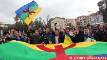epa03189817 Algerian Berber people hold Amazigh flags during a rally to commemorate the 32nd anniversary of the _Amazigh Spring_, in Tizi Ouzou city, 100 km east of Algiers, Algeria, 20 April 2012. During the _Amazigh Spring_ in 1980, Berber people, also known as Amazigh, called for the recognition of their identity and language in Algeria with political protest and civil activism mainly taking place in Kabylia and Algiers. EPA/MOHAMED MESSARA +++(c) dpa - Bildfunk+++