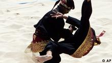 Indonesia's team performs during double men's final line of performance beach pencak silat in Asia Beach Games at Tanjung Benoa in Nusa Dua, Bali, Indonesia. Wednesday, Oct 22, 2008. (AP Photo/Achmad Ibrahim)