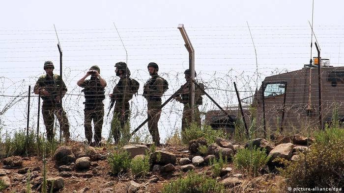 Israeli soldiers at a border fence to Lebanon Photo: EPA/HASSAN BAHSOUN