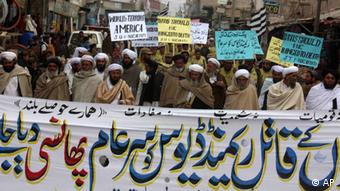 Supporters of Pakistani religious parties rally against the US embassy worker Raymond Davis, who shot dead two Pakistanis in Lahore in 2011
