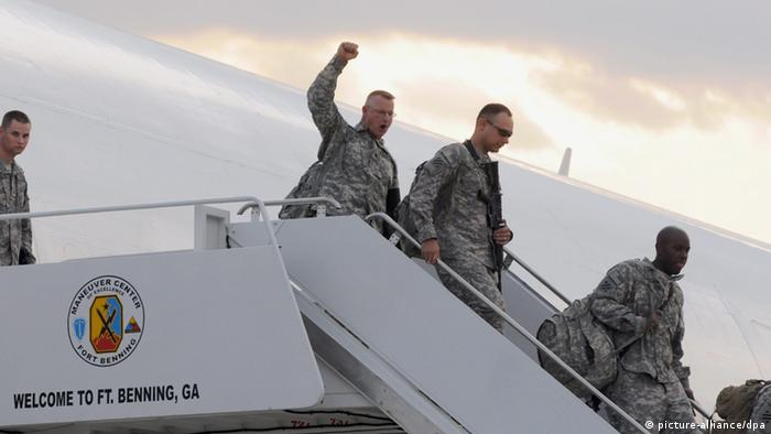 A US Army soldier raises fist while disembarking after returning from a year-long deployment in Iraq at Fort Benning, Georgia USA on 17 September 2010.