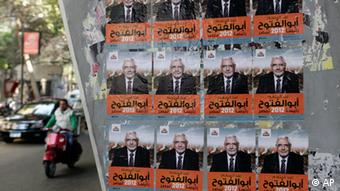 Posters supporting Egyptian Presidential hopeful Abdel Moneim Aboul Fotouh, a Muslim Brotherhood figure, are seen at a Cairo street, Egypt, March 7, 2012.