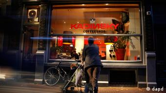 Person looks into the big front window of Cannabis coffee shop Kandinsky, in Amsterdam Photo: dapd