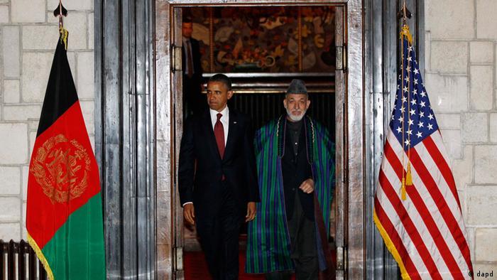 Barack Obama and Hamid Karzai arrive before signing a strategic partnership agreement