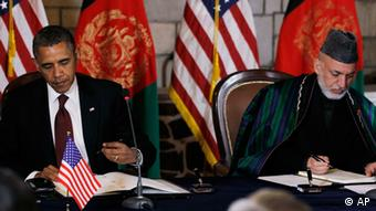President Barack Obama and Afghan President Hamid Karzai sign a strategic partnership agreement at the presidential palace in Kabul, Afghanistan