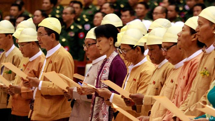Aung San Suu Kyi is sworn in to Myanmar's military-backed parliament